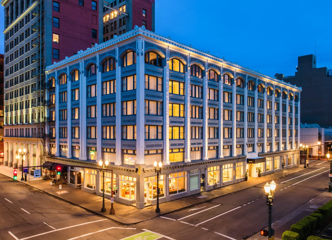 Boutique Hotels Hotels Luxury Travel building outdoor metropolitan area urban area condominium City landmark neighbourhood residential area metropolis commercial building Downtown cityscape mixed use Architecture Town tower block apartment sky hotel corporate headquarters skyscraper night daytime house real estate headquarters plaza facade home evening window tall suburb street