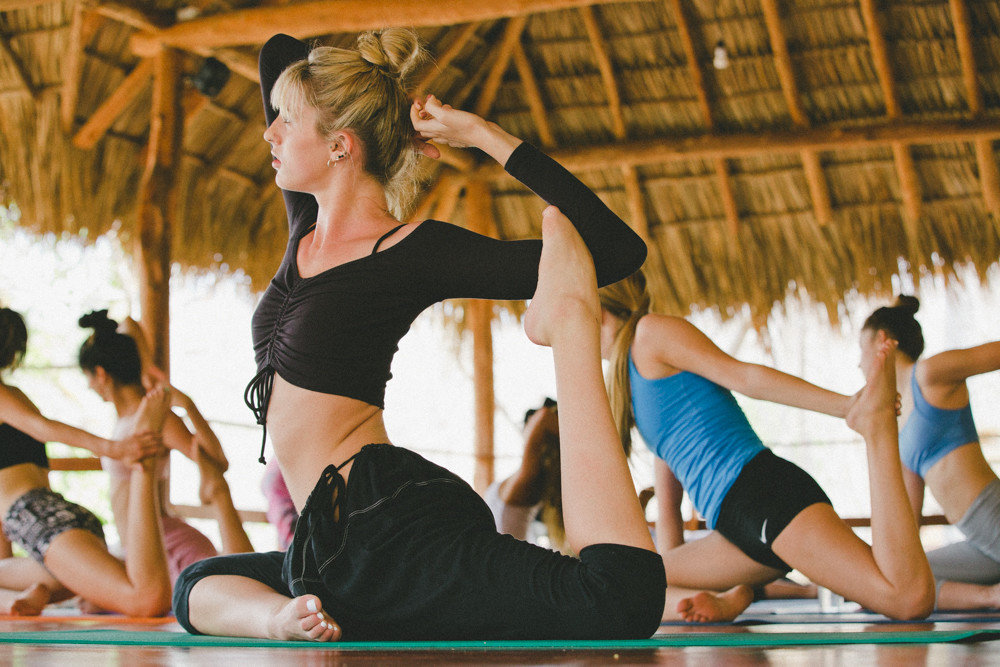 calm class exercise Health + Wellness hut isolation meditation Meditation Retreats Outdoor Activities people relaxation relaxing remote serene Spa Retreats thatched roof Trip Ideas women yoga Yoga Retreats person sports performing arts dance physical fitness Sport Entertainment event modern dance concert dance