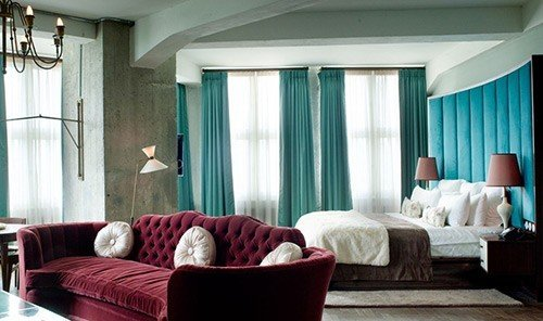 Hotels indoor floor room sofa Living window ceiling property living room red interior design Suite furniture home estate curtain window covering real estate hotel window treatment decorated Bedroom