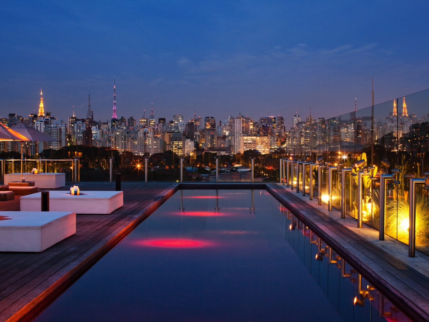 Beaches Brazil Trip Ideas sky cityscape reflection metropolitan area City waterway outdoor landmark skyline urban area water dusk metropolis night evening Architecture Downtown factory residential area lighting skyscraper horizon tourist attraction real estate Sunset long building tower block condominium line