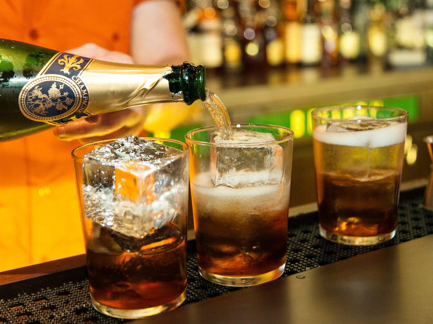 Food + Drink table cup Drink alcoholic beverage indoor distilled beverage beer cocktail beer alcohol cocktail whisky liqueur cuba libre beverage glass