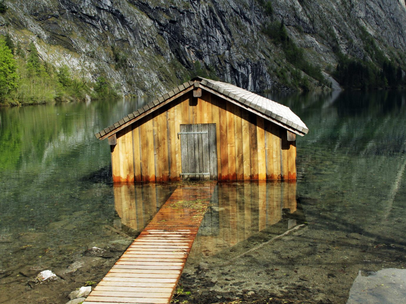 water outdoor River Lake mountain hut bridge rural area pond infrastructure reflection reservoir stone surrounded