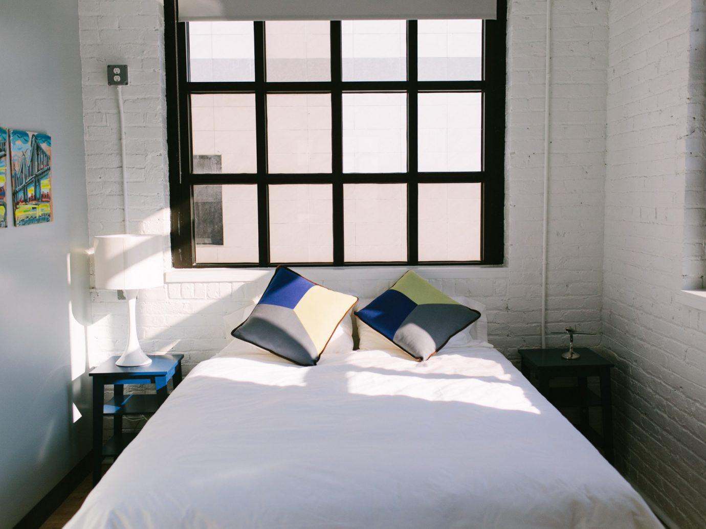 Hotels bed indoor wall window room property Bedroom building interior design white Design furniture pillow apartment Suite estate