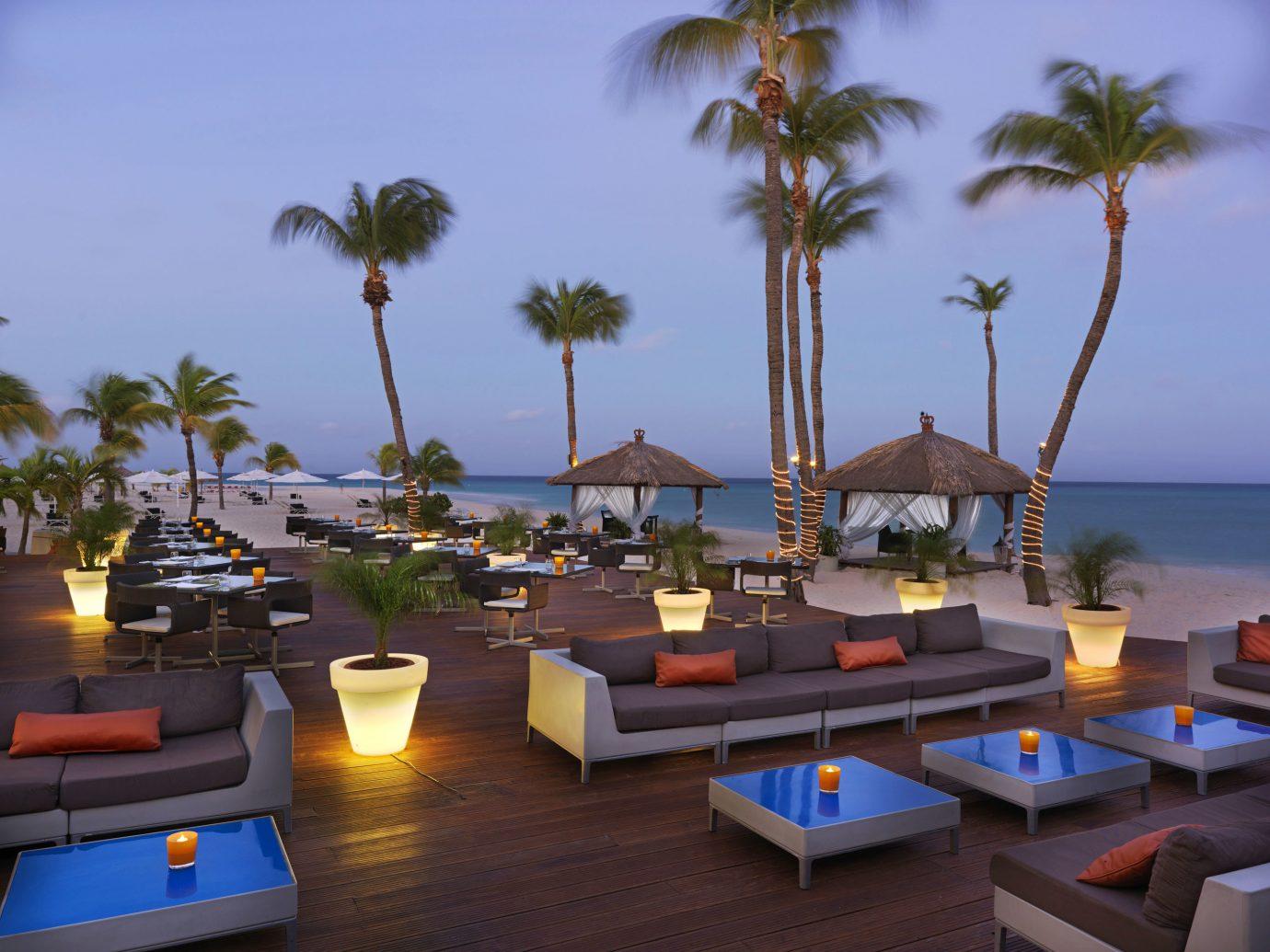 Aruba Bar Beachfront Dining Drink Eat Hotels Tropical tree sky Resort vacation palm estate arecales Beach caribbean condominium Villa Sea furniture plant