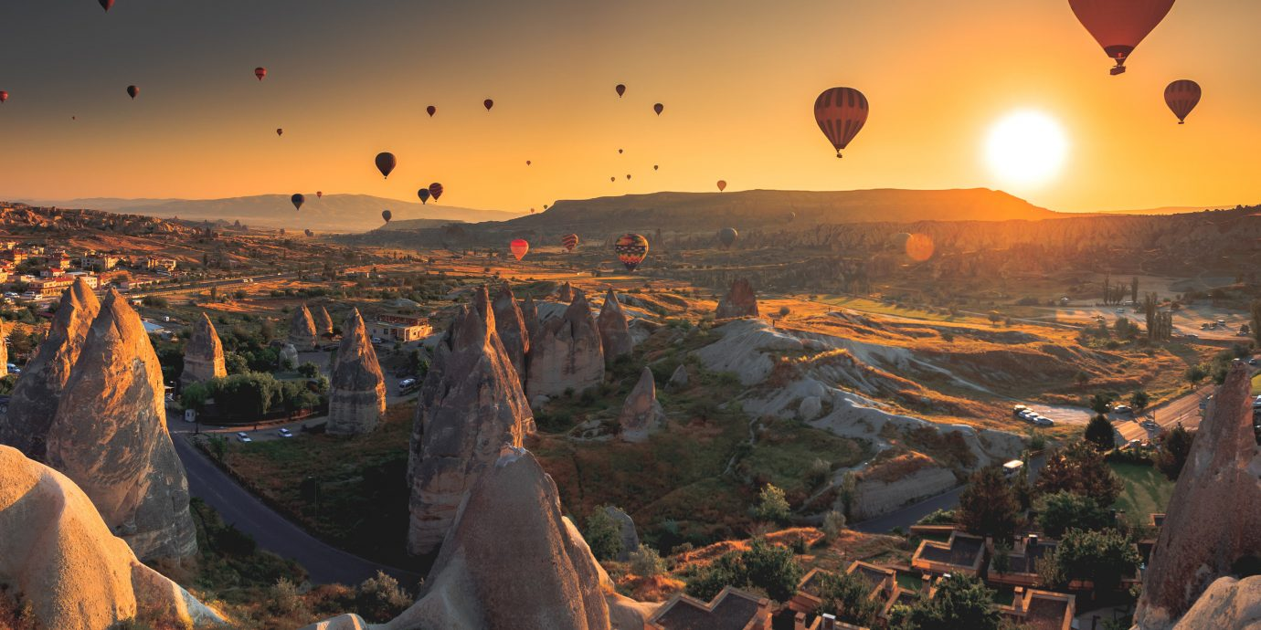 Budget Offbeat Trip Ideas sky outdoor canyon valley Nature Sunset vehicle aircraft Hot Air Balloon evening sunrise screenshot