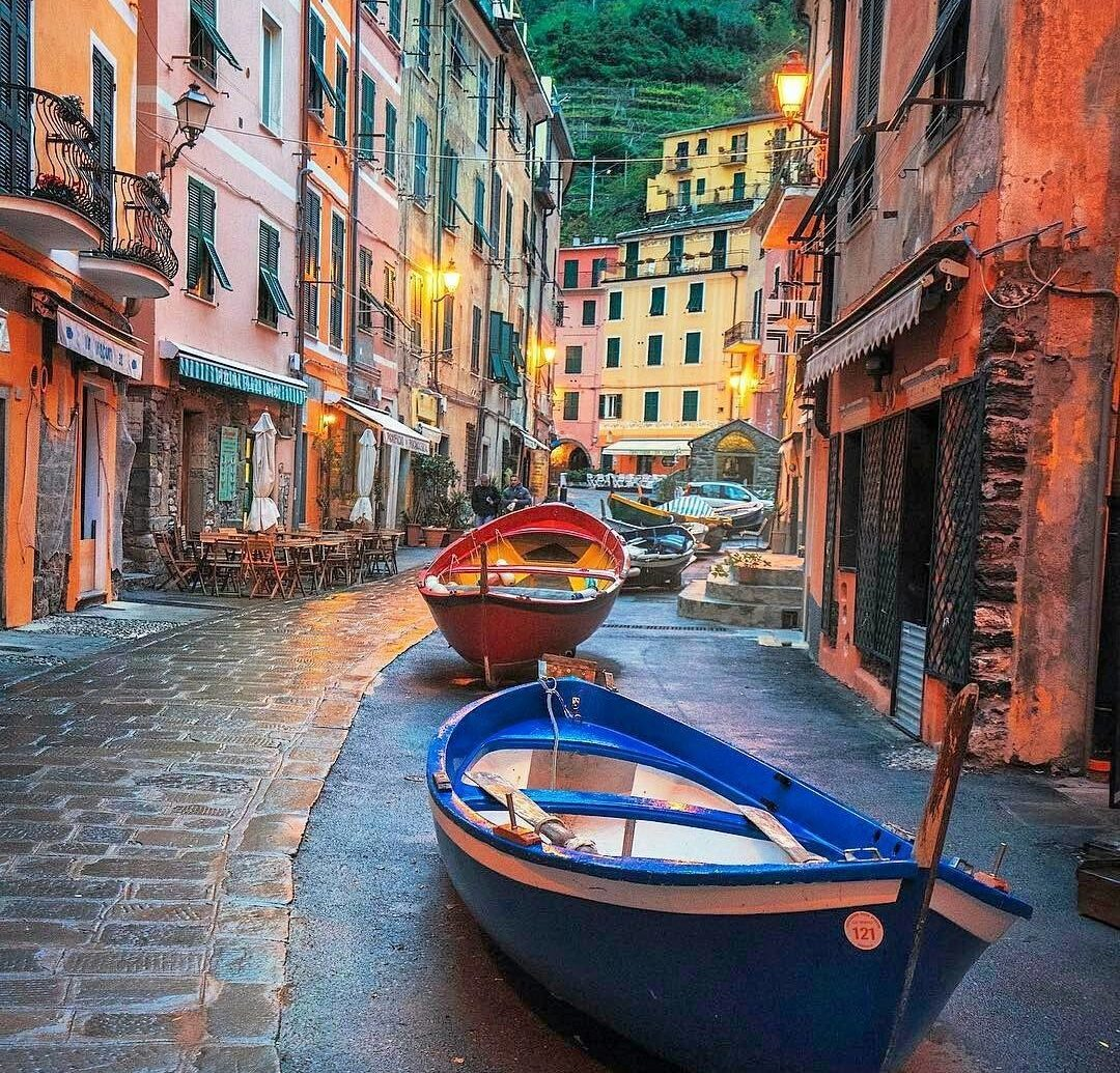 Italy Trip Ideas building ground waterway way outdoor scene water water transportation sidewalk Canal reflection Town street alley Boat gondola City neighbourhood sky channel orange stone