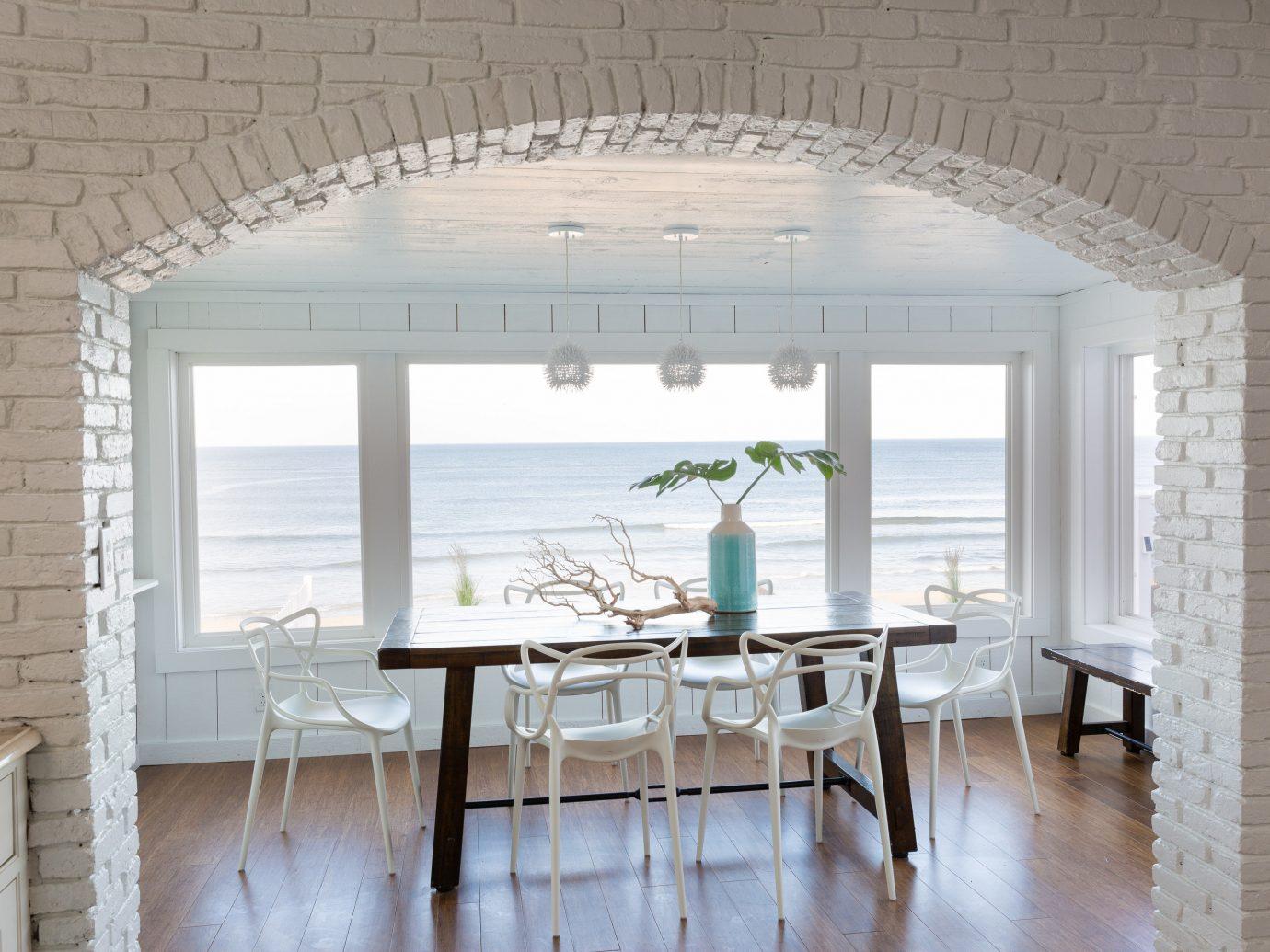 Table overlooking the ocean at Blue Inn on the Beach, MA