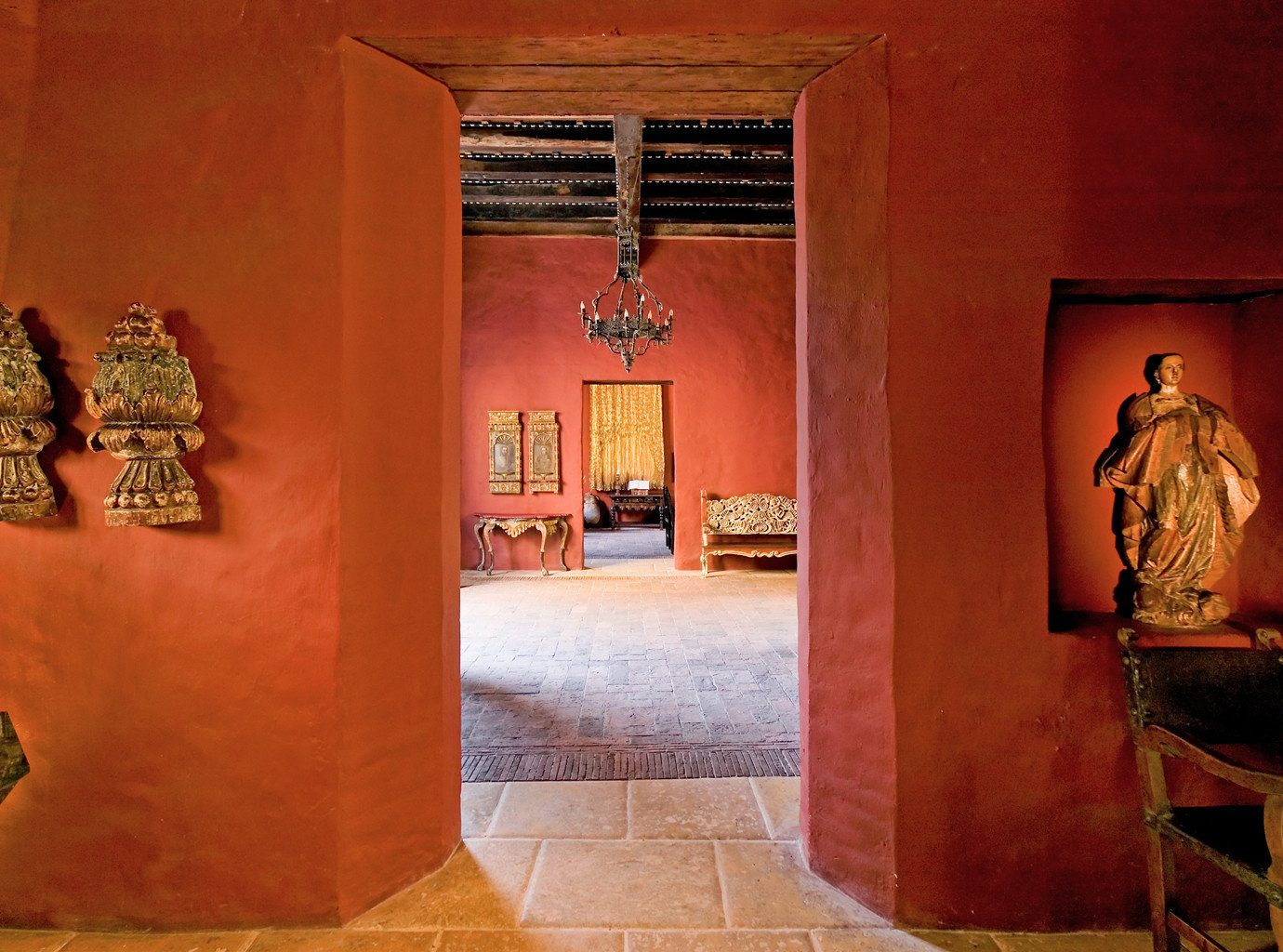 Hotels Romance red wall art ancient history tourist attraction art gallery interior design temple museum orange painted furniture altar stone