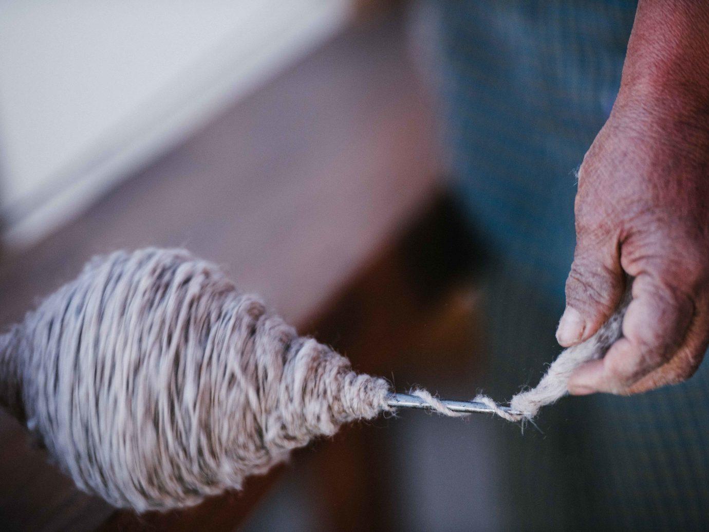 Arts + Culture Mexico Oaxaca Trip Ideas person indoor rope thread hand wool finger close feet