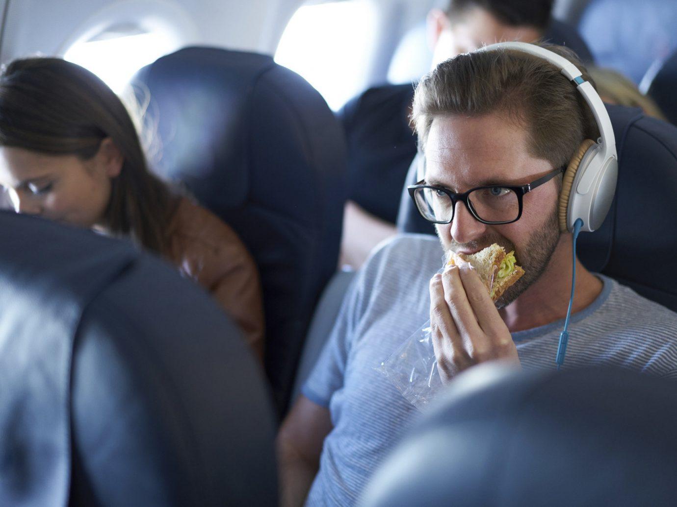 Health + Wellness Travel Tips person indoor conversation glasses