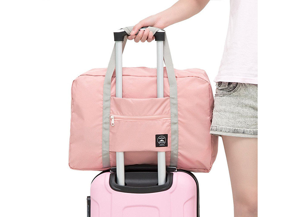 Packing Tips Travel Shop Travel Tech Travel Tips luggage person suitcase bag pink product handbag hand luggage product design case peach accessory shoulder bag baggage luggage & bags beige