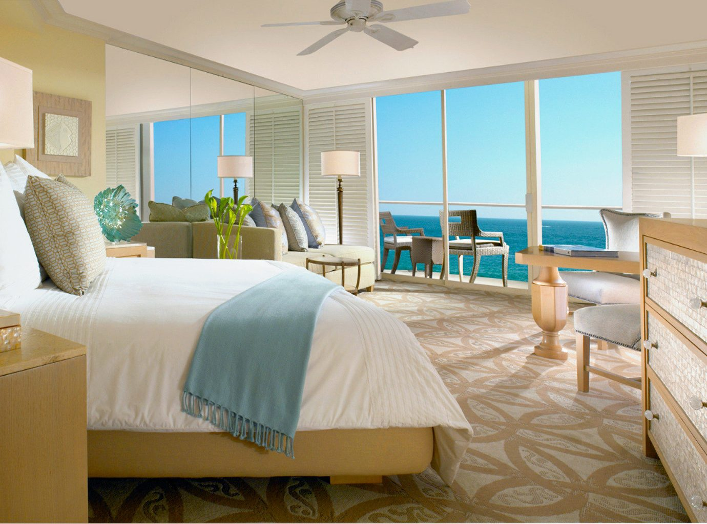 Balcony Beachfront Bedroom Elegant Hotels Living Modern Ocean Scenic views Waterfront indoor bed wall floor ceiling room window property Suite estate home real estate interior design cottage living room condominium apartment Villa furniture