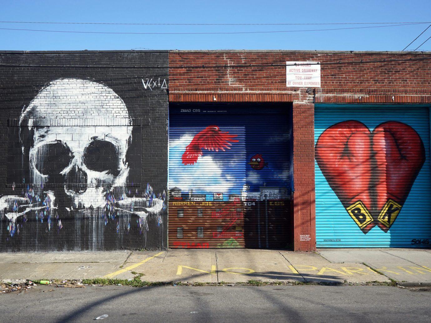 art Arts + Culture brick wall City city streets graffiti street art streets Trip Ideas urban building outdoor sky color urban area road mural wall street neighbourhood infrastructure painted