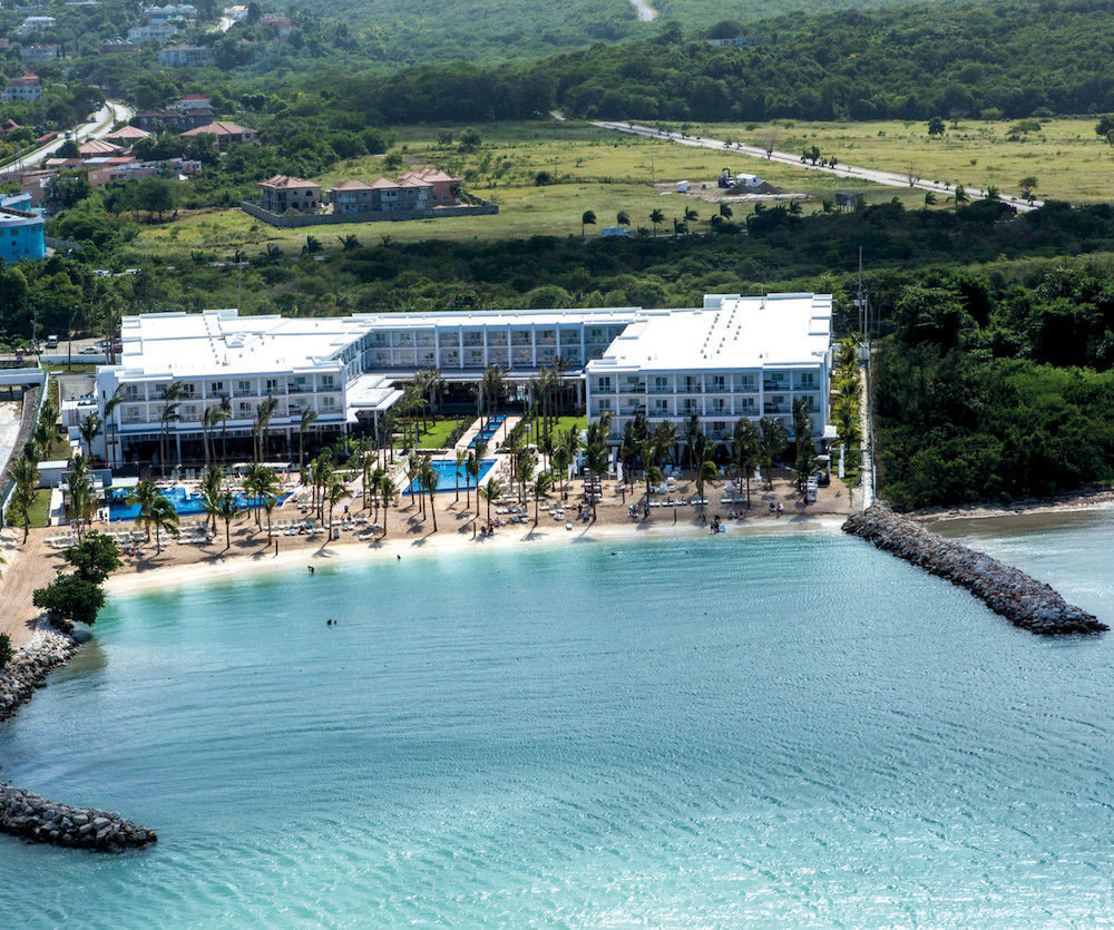 Adult-only All-inclusive Beach Beachfront Grounds mountain water swimming pool leisure scene Harbor Sea Resort Water park marina dock Lagoon swimming day shore