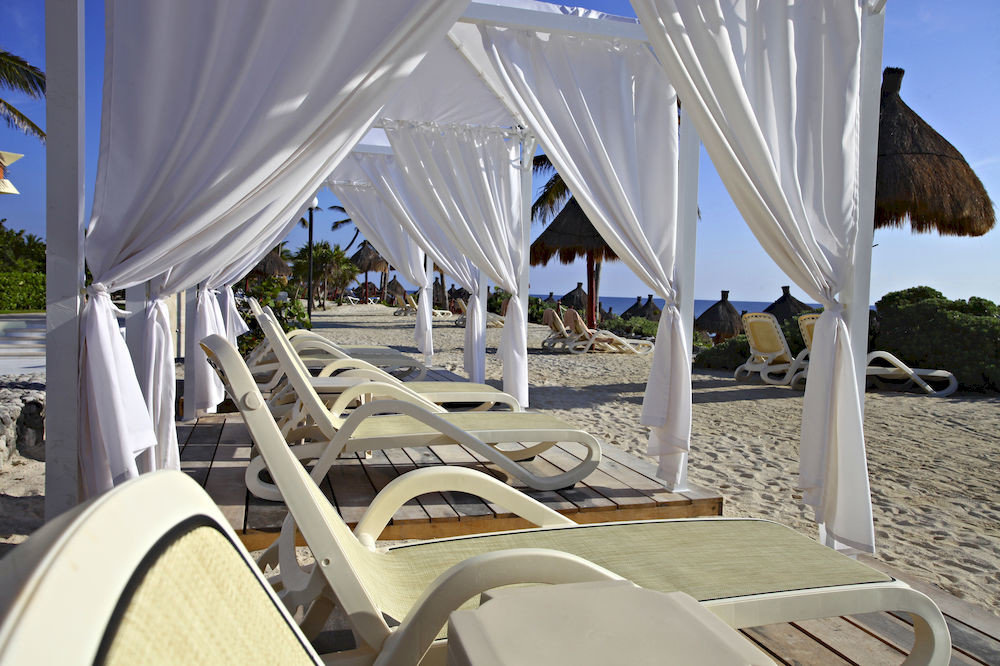 All-inclusive Family Honeymoon Resort chair ecosystem white vehicle Boat tent yacht lawn Villa caribbean day