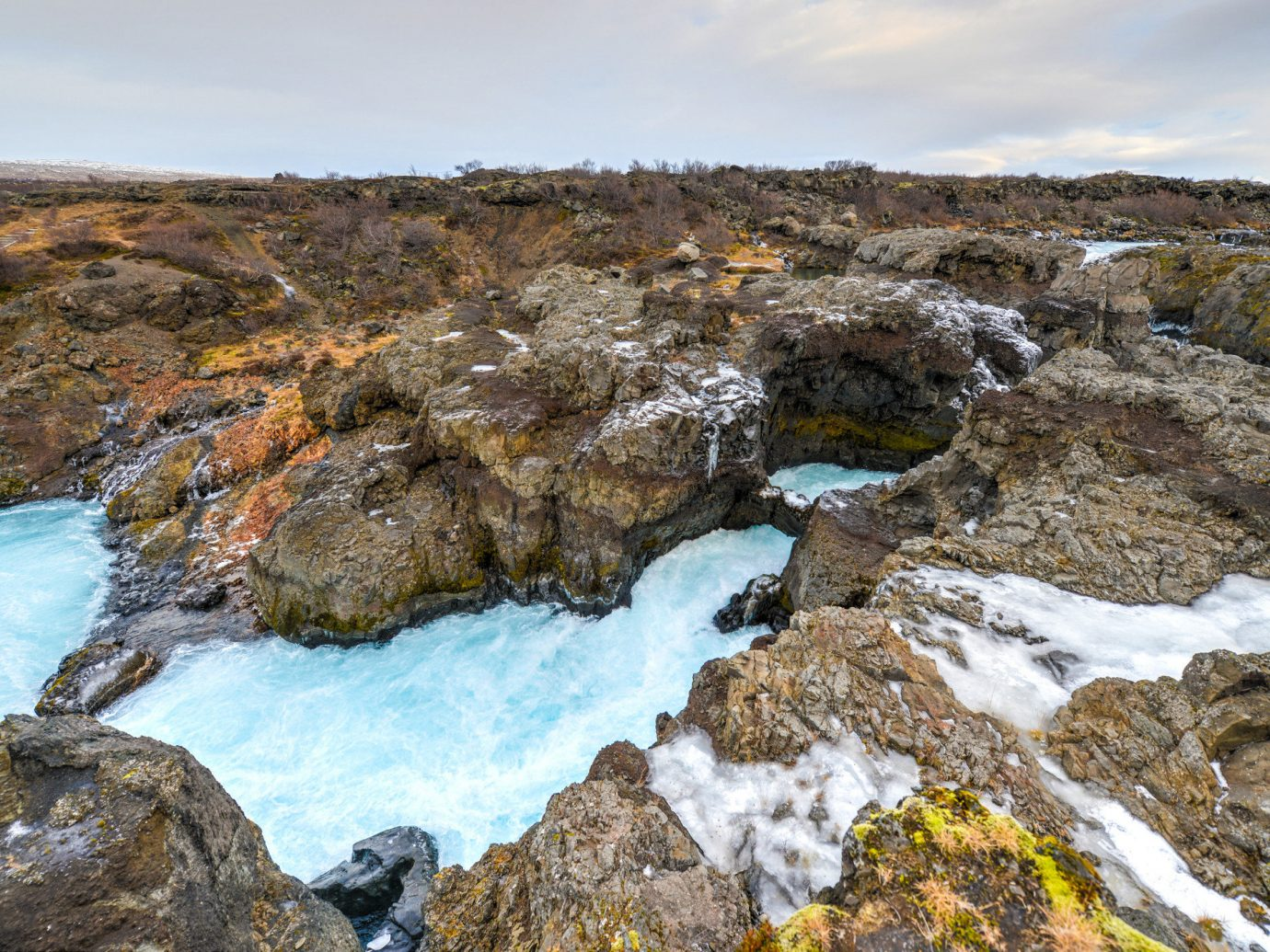 Iceland Outdoors + Adventure rock outdoor rocky water Nature mountain Coast geology formation sky bedrock stream outcrop escarpment landscape water feature watercourse hillside