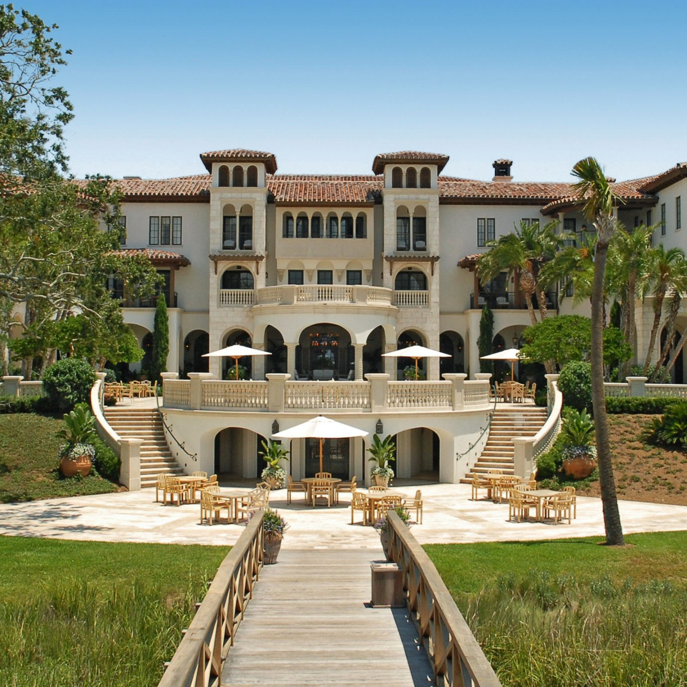 America Beach Islands Luxury Travel Trip Ideas Weekend Getaways grass sky property mansion building home Villa park historic house hacienda house landscaping Courtyard lawn official residence elevation stone walkway colonnade