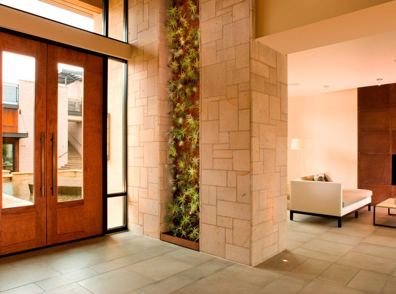 Boutique Eco Elegant Fireplace Lobby Lounge building property Architecture hardwood flooring home professional wood flooring door living room tile tiled