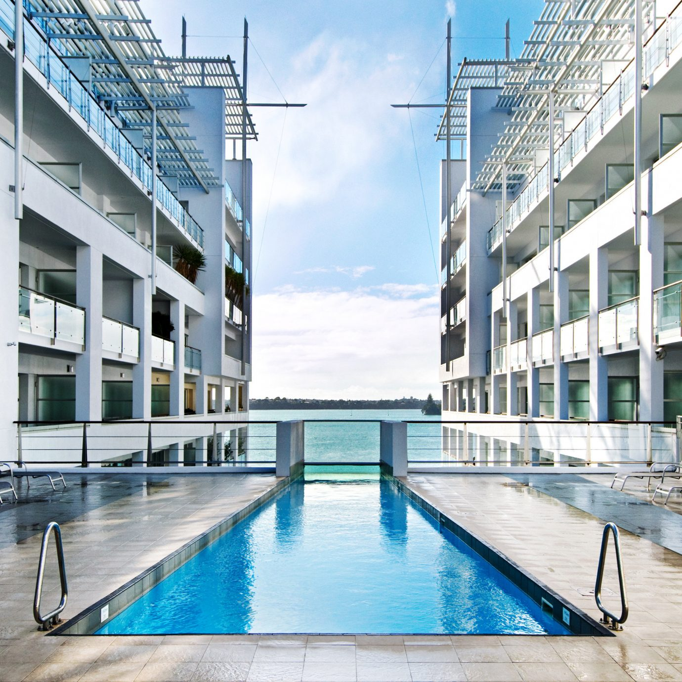 Architecture Boutique Hotels Festivals + Events Hotels Play Pool Resort Trip Ideas Waterfront water ground leisure swimming pool condominium building plaza headquarters blue swimming