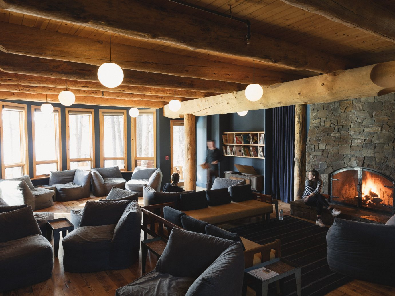 Boutique Hotels Fall Travel Hotels Outdoors + Adventure indoor Living ceiling room floor sofa Fireplace property window fire living room furniture estate cottage home interior design log cabin wood real estate farmhouse Villa area several