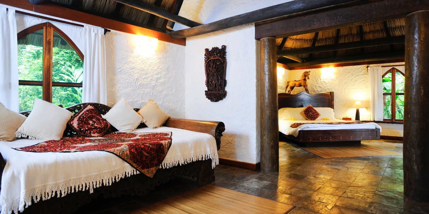 B&B Bedroom Eco Lodge Romantic Tropical property building house living room home Villa Resort cottage Fireplace Suite mansion farmhouse hacienda