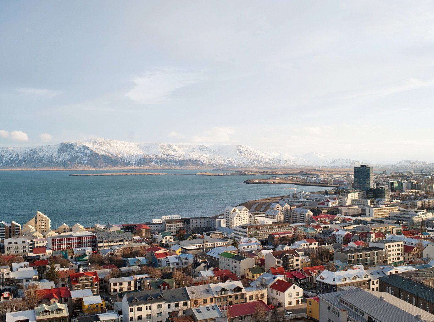 Architecture Buildings City Drink Eat Entertainment Hotels Iceland Landmarks Monuments Mountains Museums Nightlife Scenic views Shop Trip Ideas sky outdoor Town geographical feature Sea Coast scene mountain Harbor cityscape human settlement horizon bay port panorama aerial photography skyline