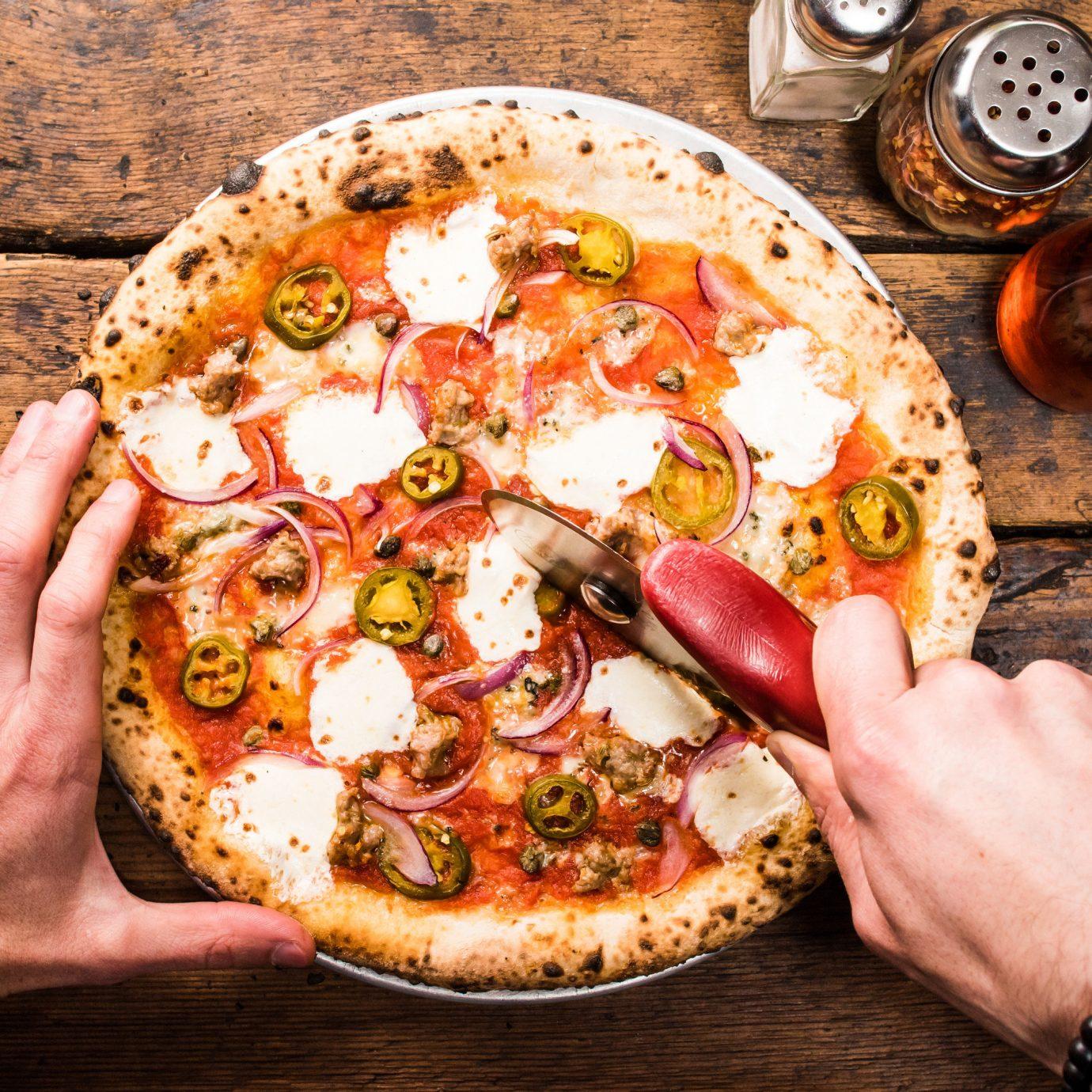 Brooklyn City Food + Drink NYC pizza dish person cuisine food italian food wooden european food pizza cheese california style pizza sicilian pizza junk food pizza stone recipe