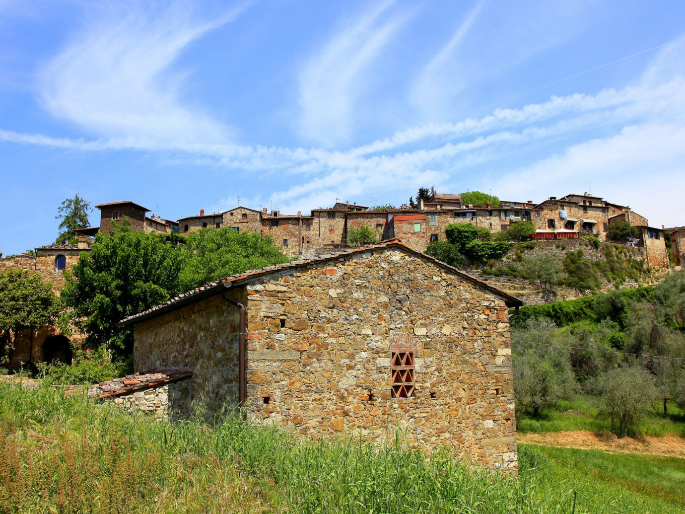Italy Trip Ideas sky property Village rural area cottage house cloud tree grass home mountain farmhouse estate meadow facade field historic site hill landscape roof plant grassland