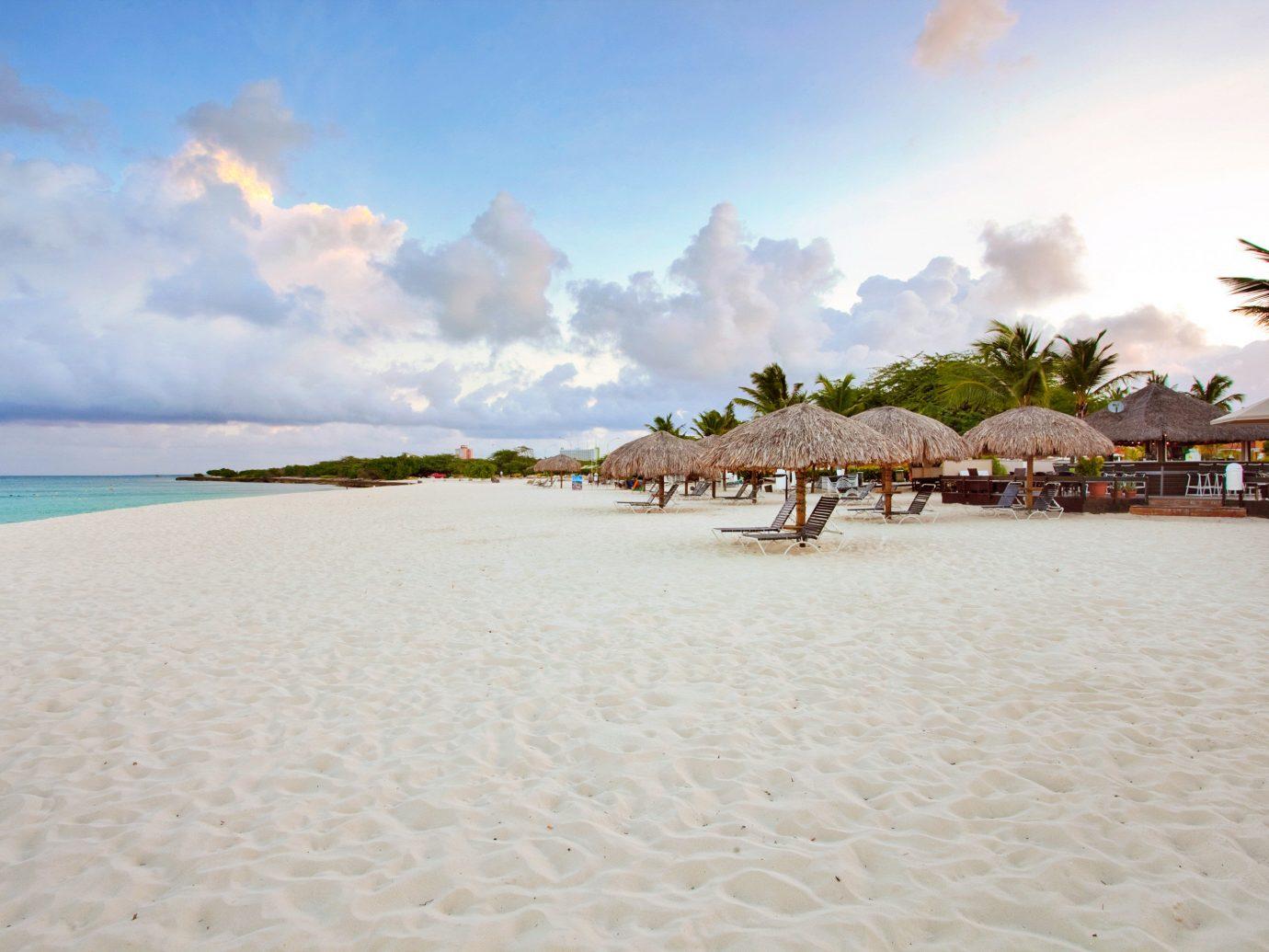 Beach Hotels Resort Romance outdoor sky water Nature shore body of water Sea vacation Ocean sand Coast caribbean bay sandy day