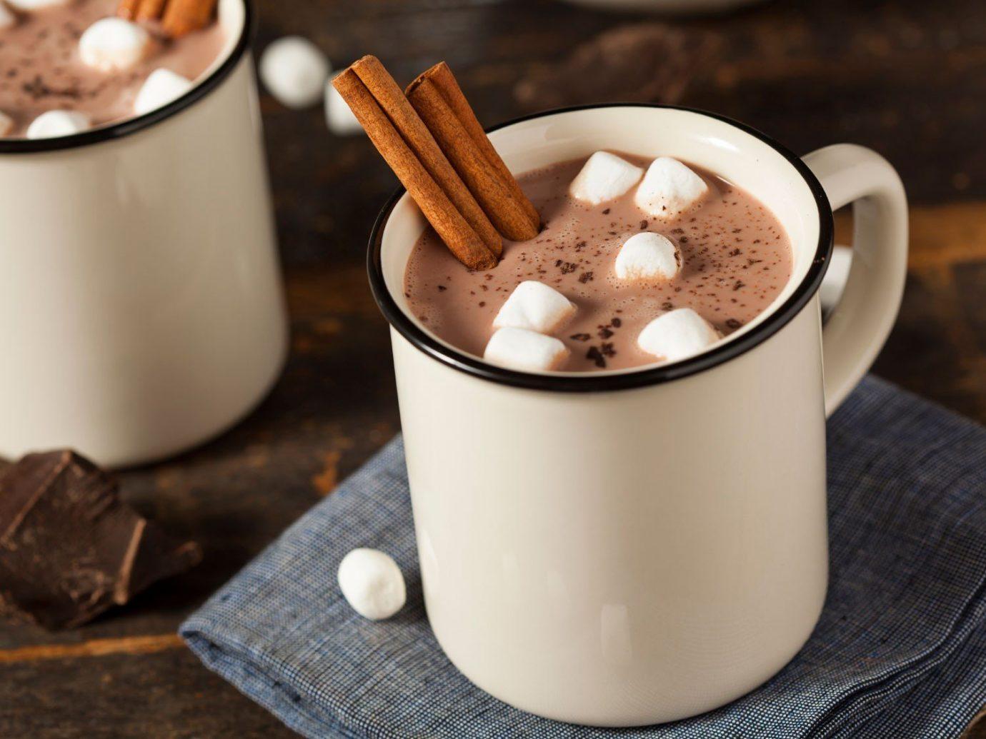 Food + Drink cup coffee table indoor food dessert milkshake Drink breakfast hot chocolate dairy product flavor chocolate meal coconut produce