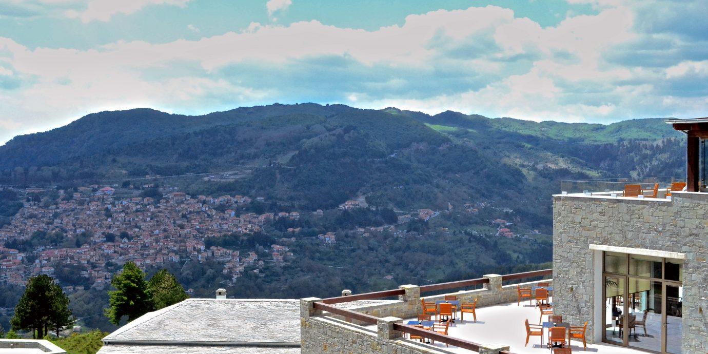 Balcony Bar Honeymoon Mountains Outdoors Pool Rooftop Scenic views mountain sky house Sea mountain range Coast reservoir Lake