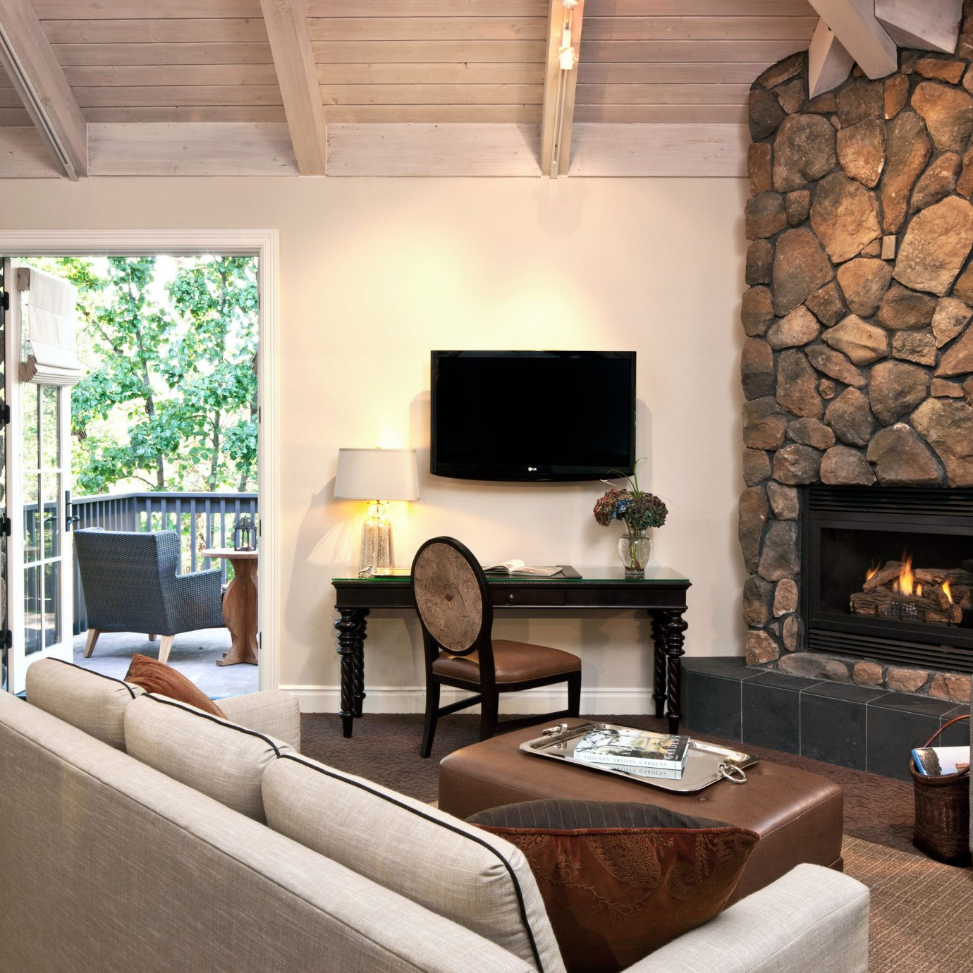 Balcony Fireplace Rustic Scenic views Suite sofa living room property fire home hearth hardwood cottage flat Bedroom stone