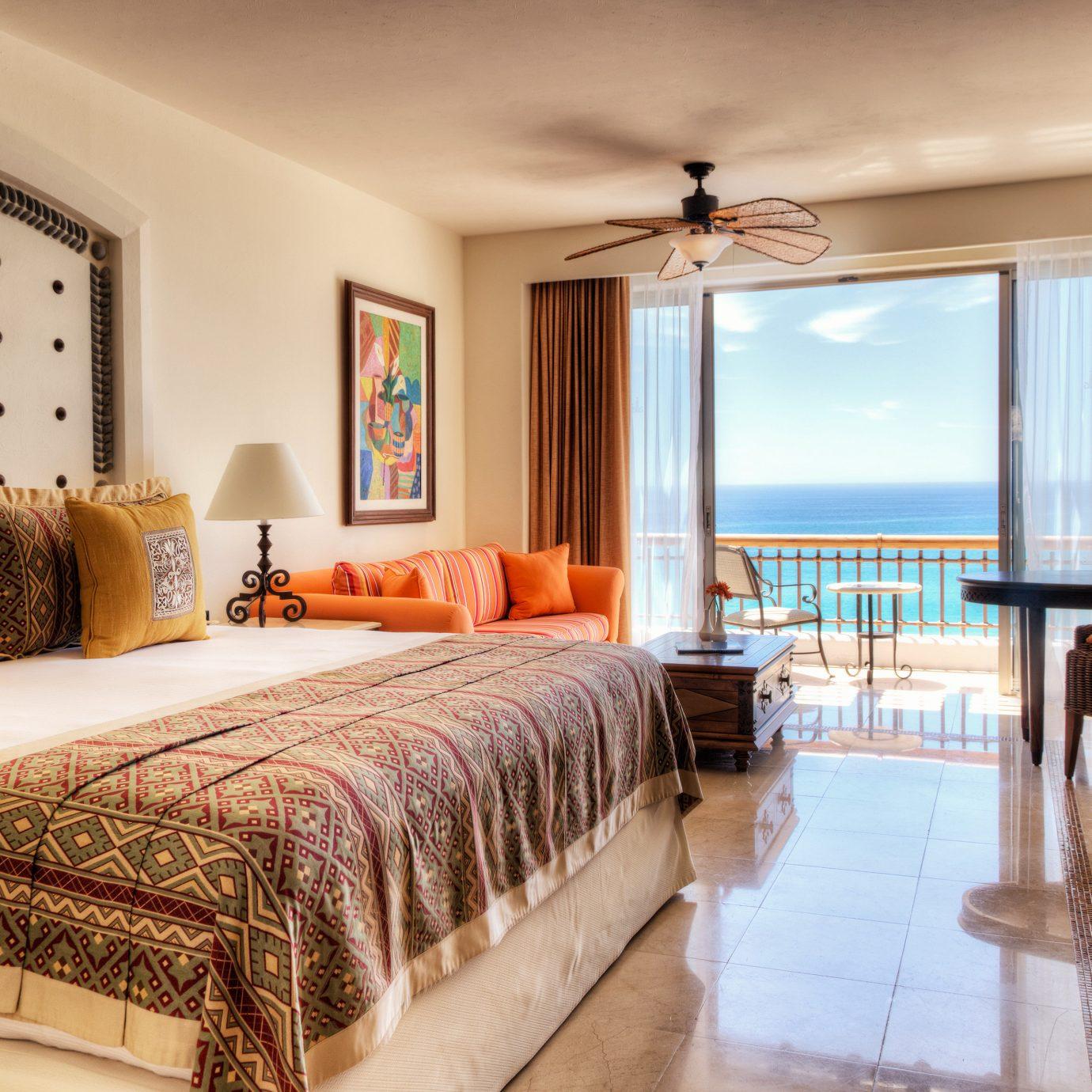 Balcony Bedroom Lounge Scenic views Suite sofa property Villa Resort cottage condominium living room mansion flat