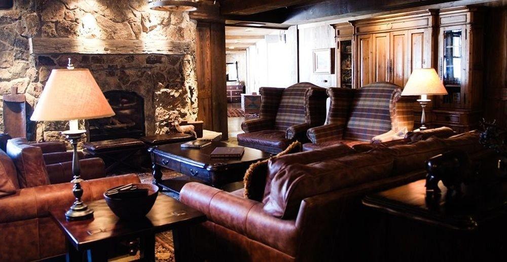 sofa property living room home Bar cottage screenshot restaurant lamp leather