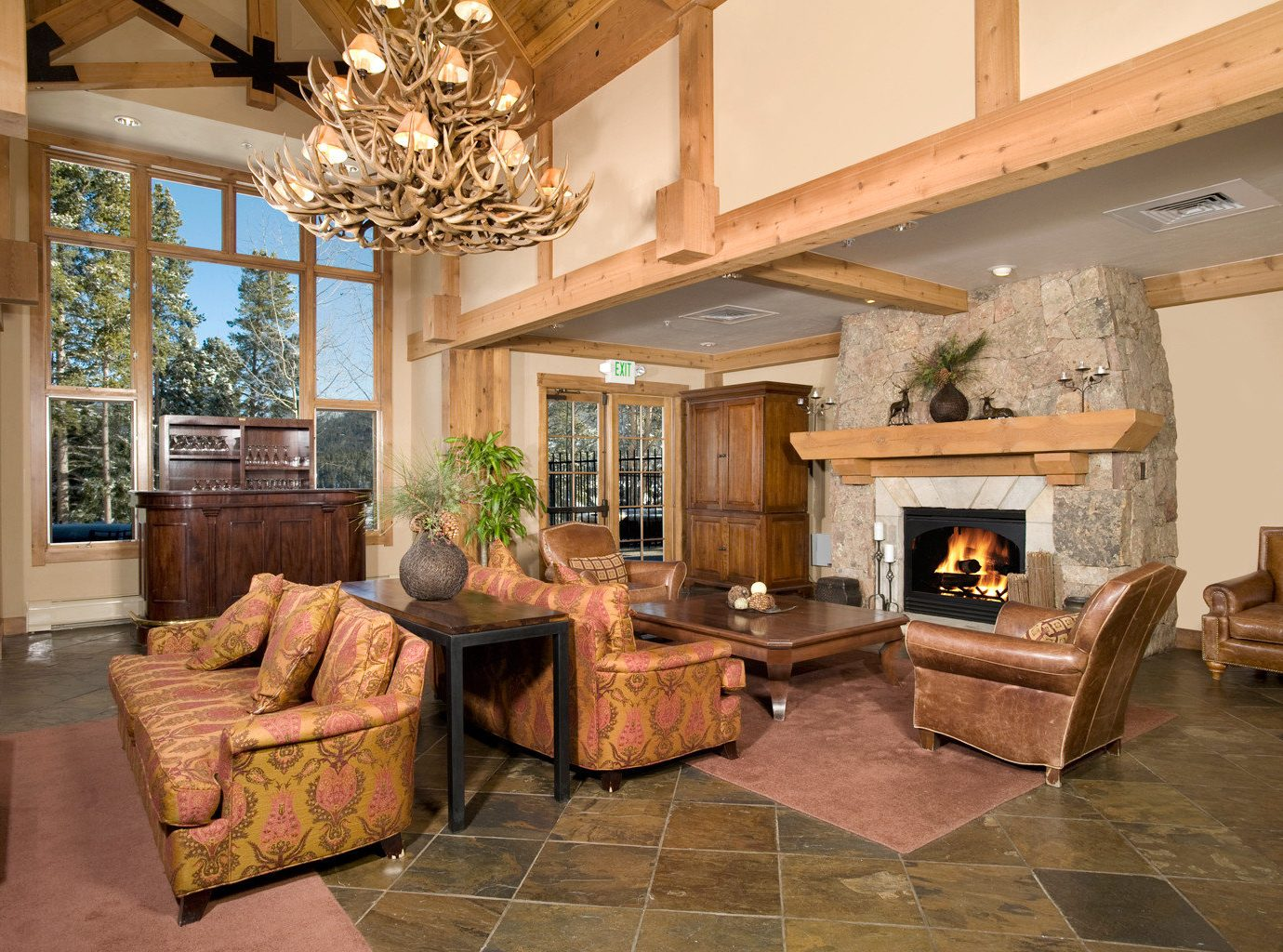 Bar Fireplace Lodge Lounge Rustic Scenic views sofa living room property home fire house hardwood cottage mansion Villa farmhouse wood flooring