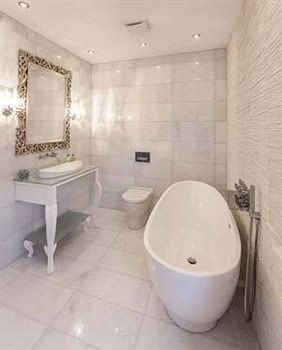 bathroom property sink toilet bidet plumbing fixture white bathtub flooring Bath tile tiled tub