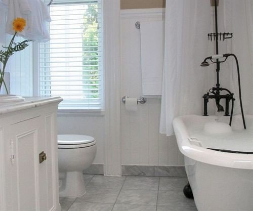 bathroom property white toilet plumbing fixture bidet sink cottage tub tile tiled bathtub Bath
