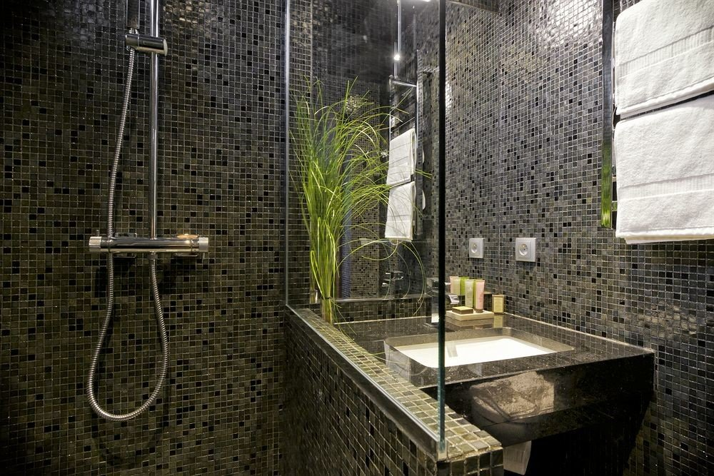 bathroom house brick tiled tile mansion plumbing fixture tourist attraction stall public stone Bath tub bathtub