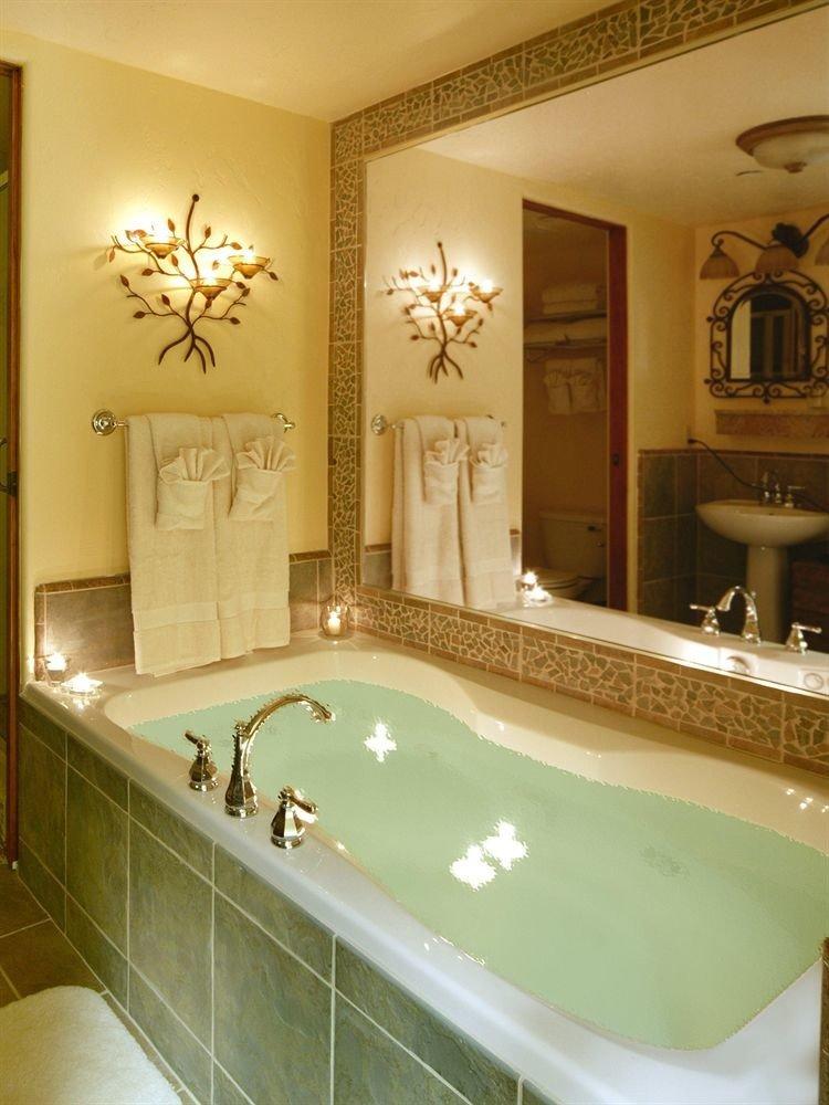 bathroom mirror sink property bathtub swimming pool plumbing fixture tile Bath
