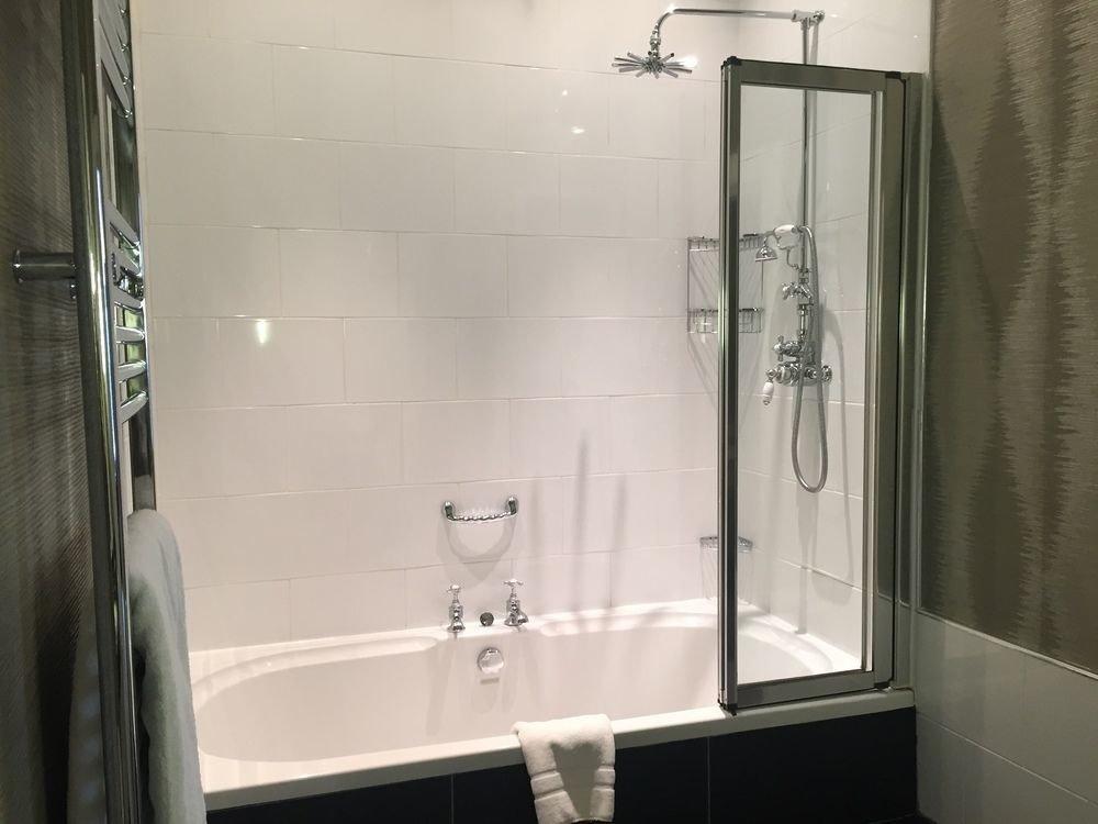bathroom shower toilet scene plumbing fixture white sink bathtub Bath tiled