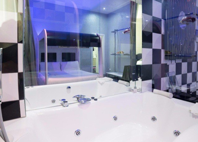 bathroom property purple toilet sink Suite vessel jacuzzi bathtub amenity glass flooring tiled tile tub Bath