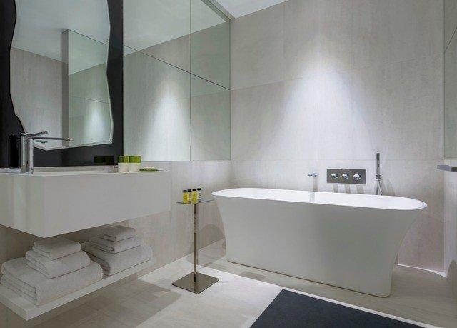 bathroom property bathtub plumbing fixture bidet sink flooring toilet
