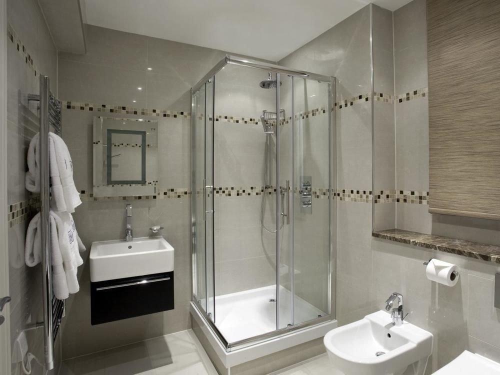 bathroom sink mirror toilet white plumbing fixture shower bathtub bidet tile