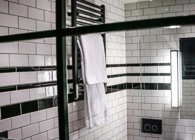 bathroom tiled toilet tile flooring glass public