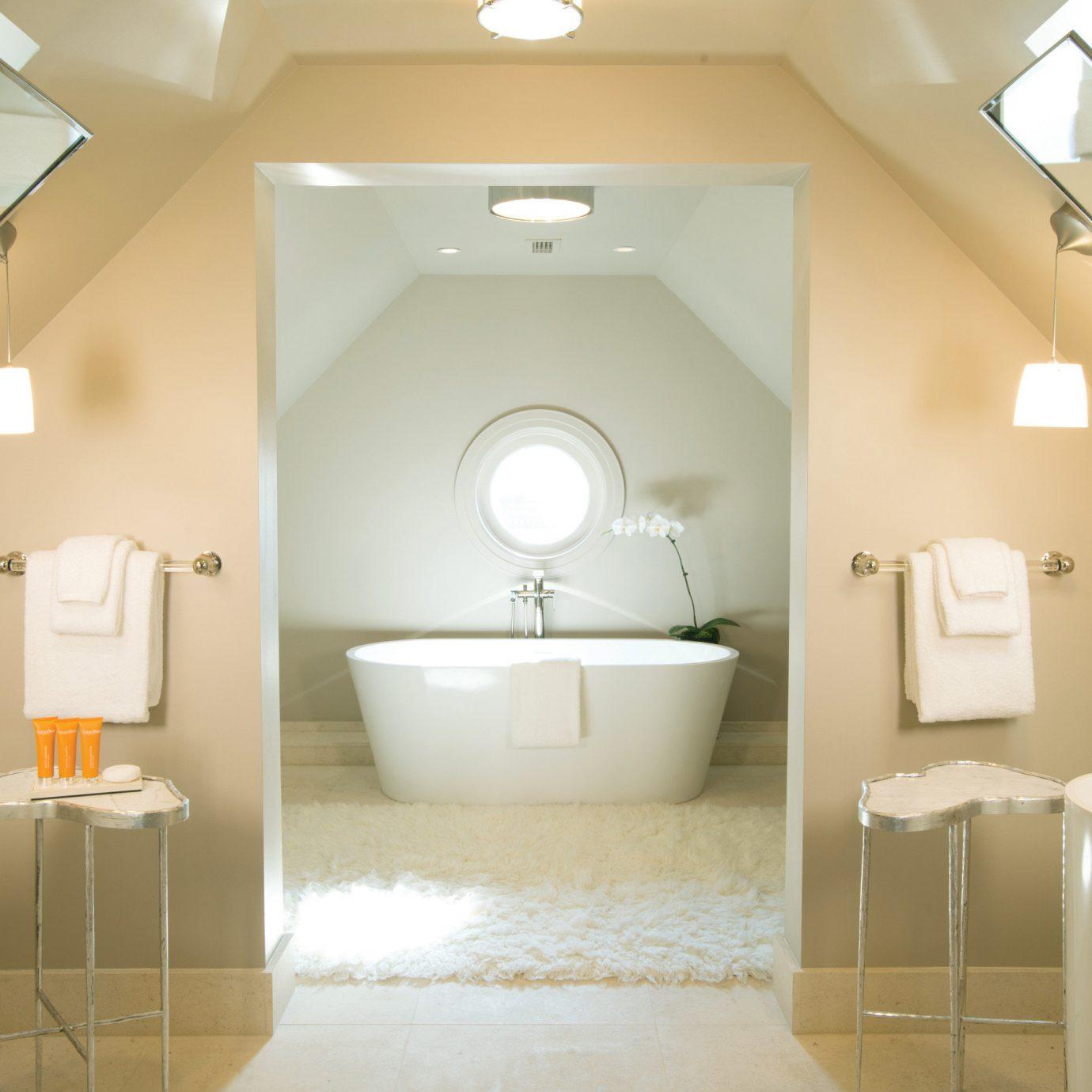 bathroom mirror property toilet sink towel home plumbing fixture rack tan tub