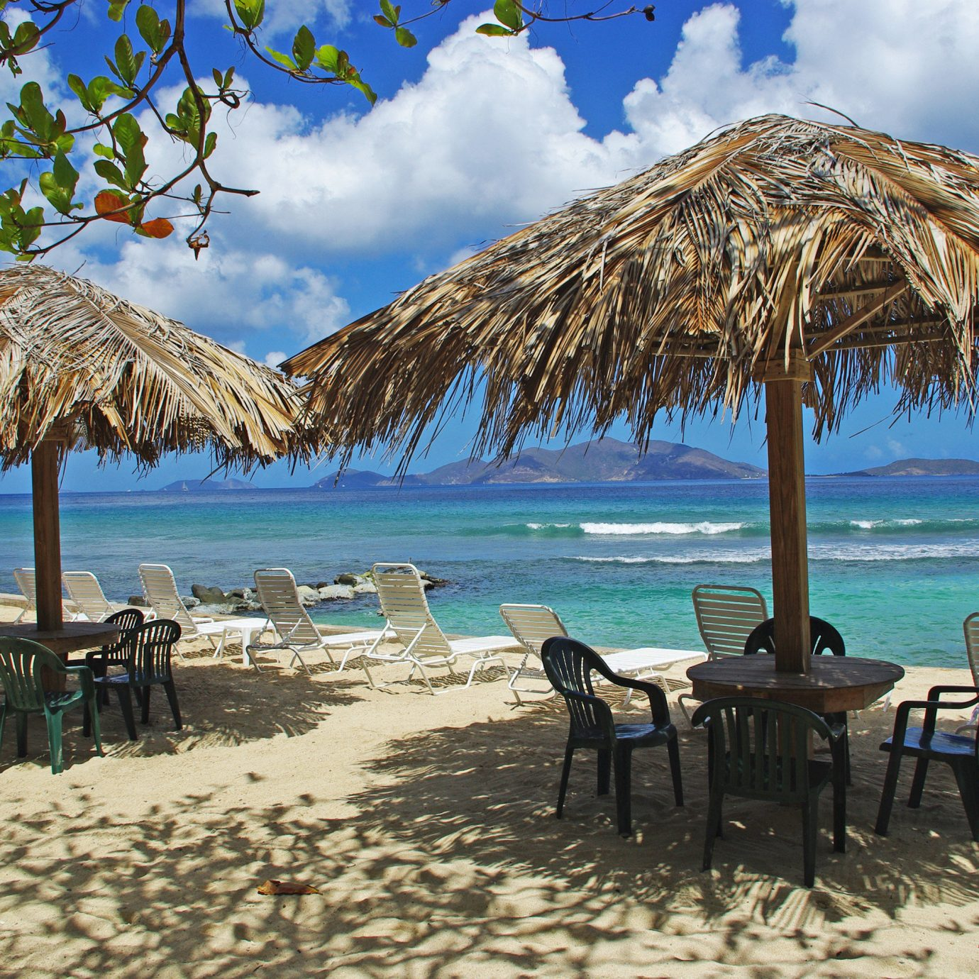 Beach Beachfront Grounds Luxury Ocean Resort umbrella chair water sky ground lawn Sea shore Nature Coast arecales caribbean sand cape Island lined Lagoon tropics set palm swimming day line sandy shade
