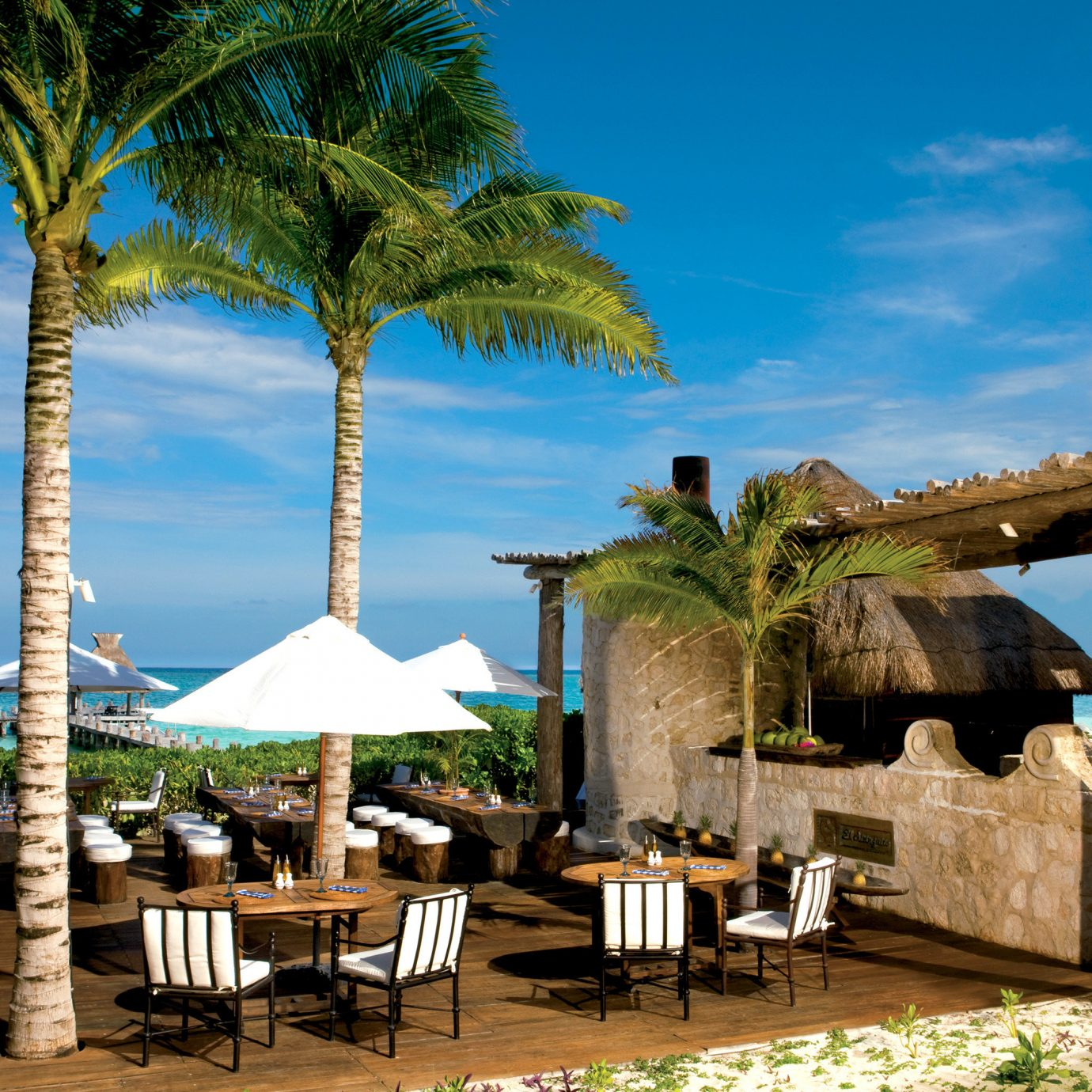 Beach Beachfront Deck Dining Hotels Lounge tree chair property Resort hacienda arecales wooden Villa caribbean plant