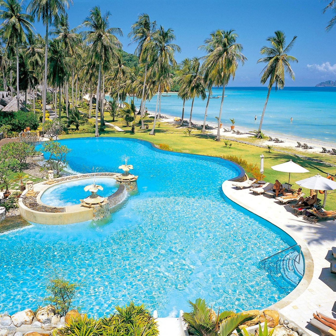 Beach Beachfront Island Ocean Pool Resort Romantic Sea Tropical Waterfront tree water umbrella palm chair lawn reef Nature leisure swimming pool caribbean lined swimming resort town Lagoon blue Garden shore surrounded shade