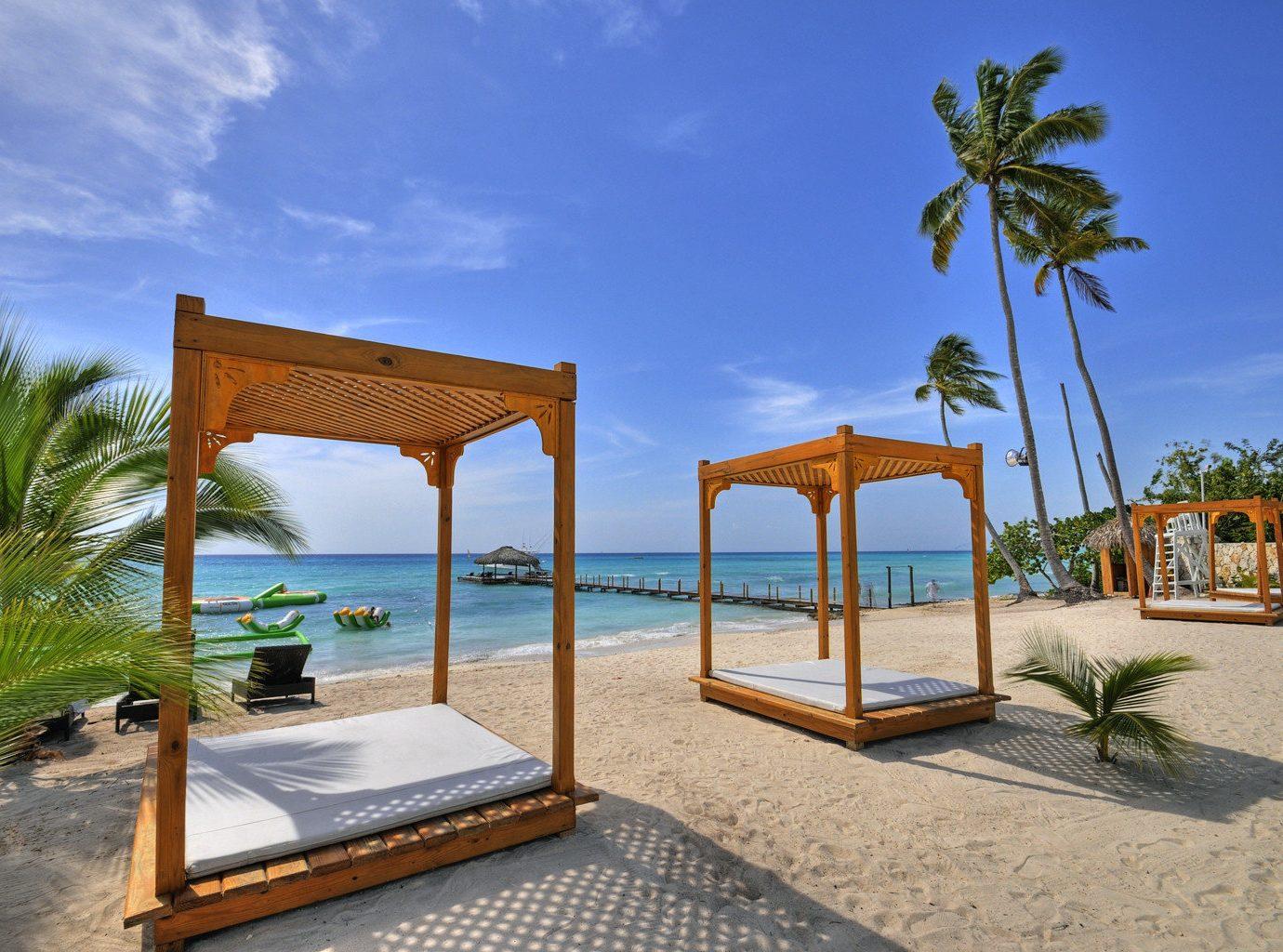 Beach Beachfront Lounge Luxury Ocean sky ground chair leisure property Resort caribbean Villa swimming pool palm Pool home Sea hacienda condominium sandy shade day