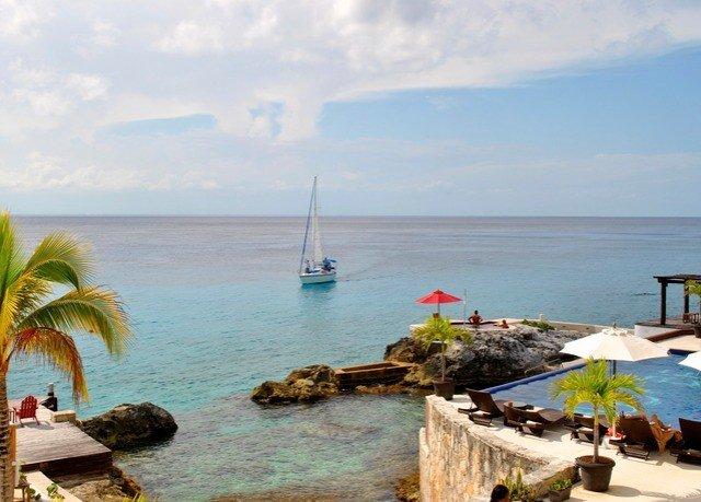 water sky Sea shore Coast Beach Ocean caribbean cove Nature cape Island Resort vehicle overlooking